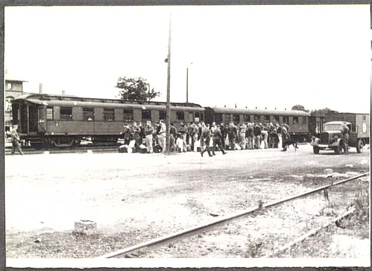 POWs at Barth, Germany train awaiting march to camp.
